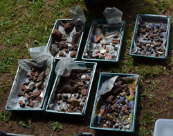 Trays of archaeological finds drying outside